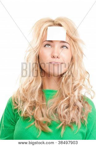 Beautiful And Pensive Young Woman With Sticky Note On Her Forehead.