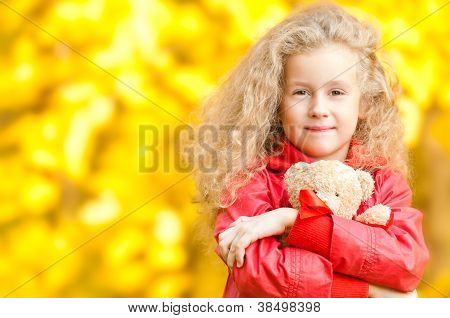 Beautiful Little Girl With Teddy Bear