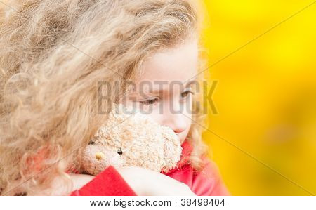 Beautiful Little Girl With Teddy Bear.