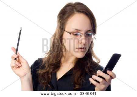 Attractive Business-Woman Holding A Pencil And A Cellphone