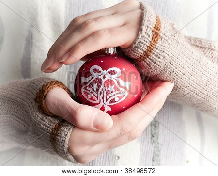 Woman Holding Christmas Toy