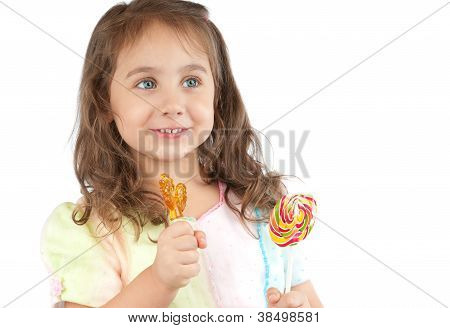 Happy Little Girl Holding Two Candies In Her Hands