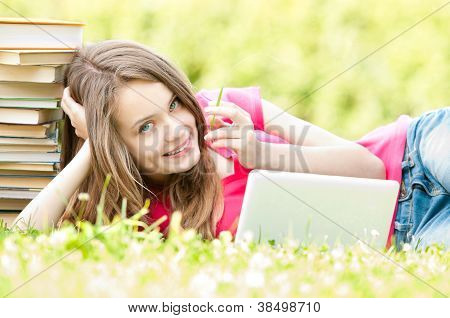 Happy Student Girl Lying On Grass With Laptop Computer