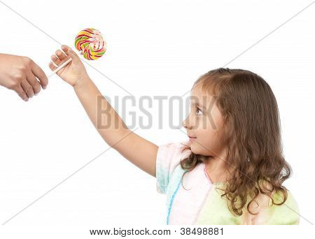 Happy Little Girl Taking Candy From Her Mother