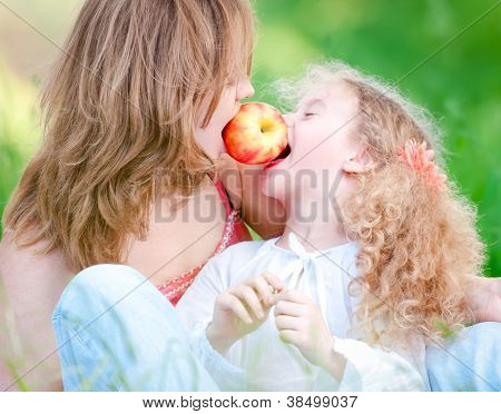 Young Mother And Her Daughter Eating