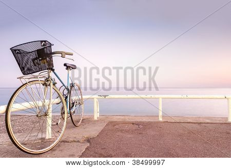 Old Bicycle At Sea Side.
