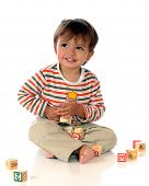pic of happy baby boy  - Happy baby boy playing with alsphabet blocks - JPG