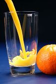 pic of orange-juice  - pouring oj - JPG