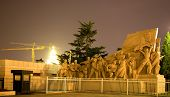 foto of zedong  - Mao Statue in front Mao Zedong Tse Tung Tomb Tiananmen Square Beijing China Night Shot Yellow Building Crane in Background