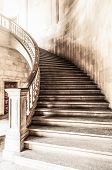 stock photo of stairway  - Marble winding staircase with high solid handrails in hall leading up - JPG