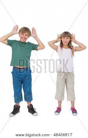Funny children being silly on white background