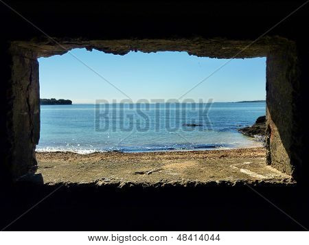 View through a bunker window onto the sea