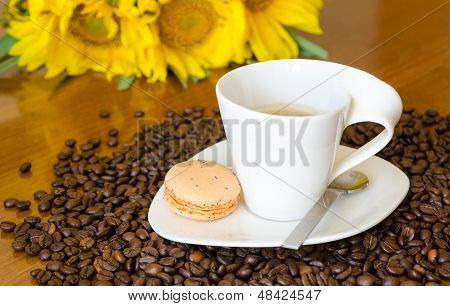 Coffee Cup And Sunflowers