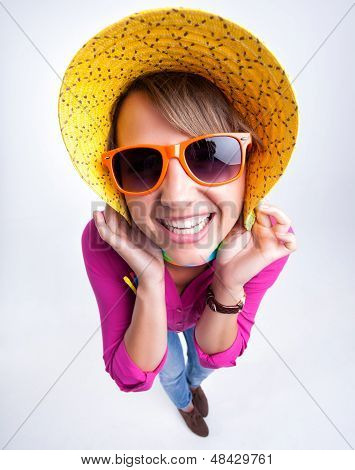 Pretty Girl With Funny Hat Smiling In The Studio