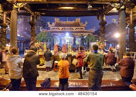 TAIPEI, TAIWAN - JANUARY 11: Worshippers at Longshan Temple January 11, 2013 in Taipei, TW. The temple was built in 1738 by settlers from Fujian.