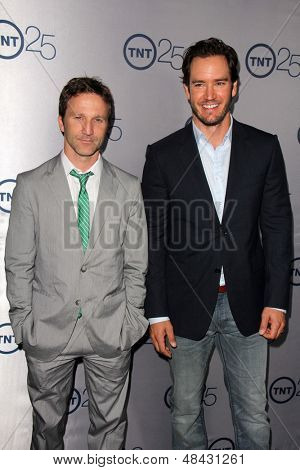 LOS ANGELES - JUL 24:  Breckin Meyer, Mark-Paul Gosselaar arrives at TNT's 25th Anniversary Party at the Beverly Hilton Hotel on July 24, 2013 in Beverly Hills, CA