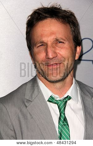 LOS ANGELES - JUL 24:  Breckin Meyer arrives at TNT's 25th Anniversary Party at the Beverly Hilton Hotel on July 24, 2013 in Beverly Hills, CA