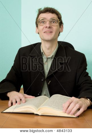 Guy In Eyegasses Reads The Book