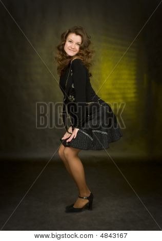Beauty Girl In Black On Dark Background