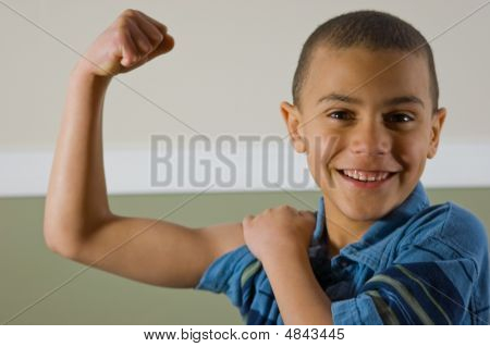 9 Year Old Multi Racial Boy Showing Off His Muscles