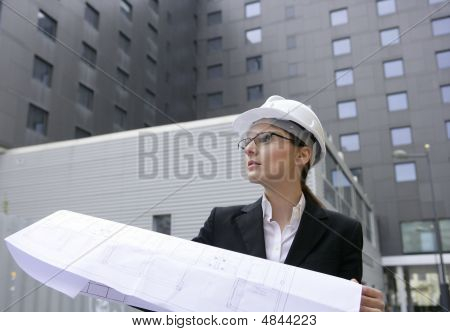 Architect Woman Working Outdoor With Buildings