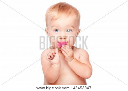 Cute Baby With Food Spon In Mouth