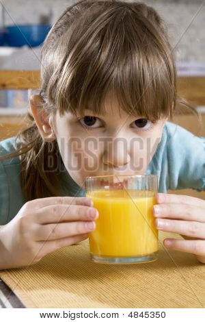 Little Cute Girl Drink Orange Juice