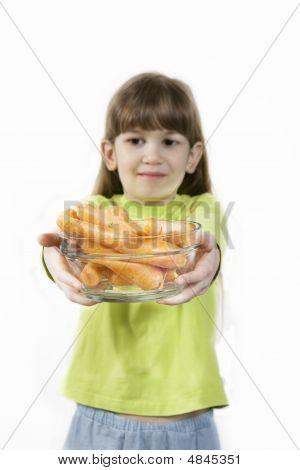 Little Cute Girl Holding Carrot