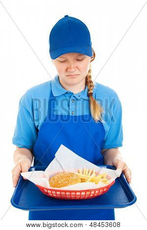 Teen worker disgusted by fast food meal.  Isolated on white.