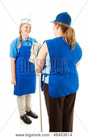 Adult boss hands a mop to a cheerful teenage worker.  Isolated on white.