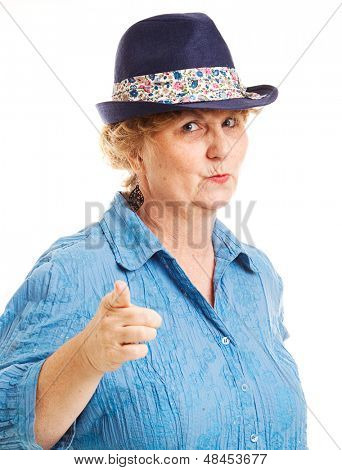 Portrait of a mature woman pointing at the camera.  Isolated on white.