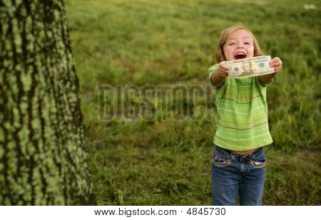 Beautifull Happy Little Girl With Dollar Note
