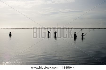Fishermen In The Morning Sun,  Ocean Coast, Indonesia