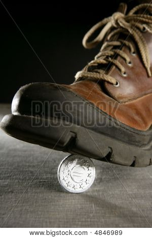 Euro Currency Coin Tread By A Boot
