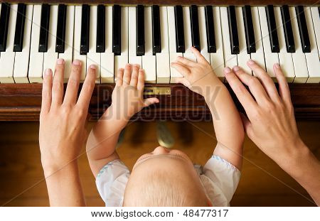 Baby Learning To Play Piano With Mother