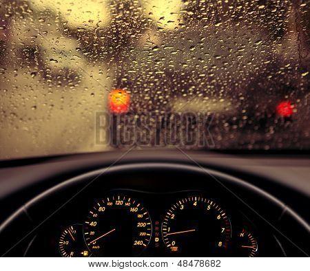 rain droplets on car windshield, blocked traffic