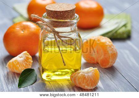 Tangerine Oil In A Glass Bottle
