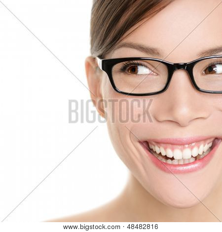 Woman wearing glasses looking happy to side. Eyewear woman with big smile wearing eyeglasses. Close up portrait of female spectacles model isolated on white background. Mixed race Asian Caucasian girl