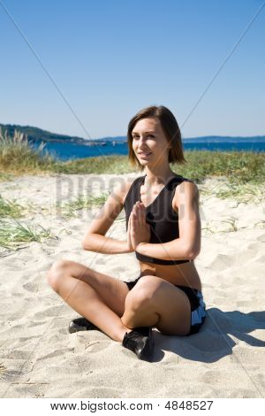 Yoga Girl On The Beach