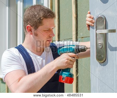 Young Handsome Handyman Using Screwdriver
