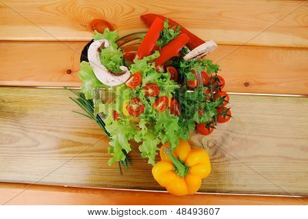 image of vegetables in salad on wood