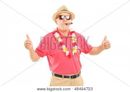 Mature gentleman smoking a cigar and giving thumbs up isolated on white background