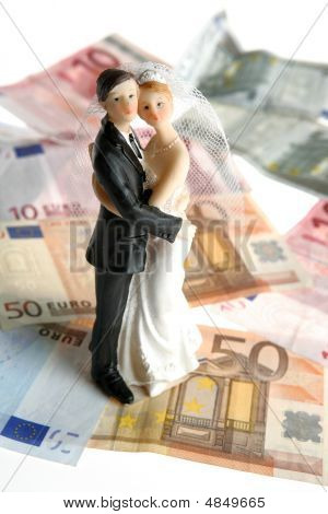 Wedding Couple Figurine Over Euro Notes