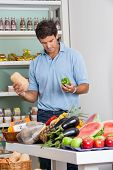 picture of brinjal  - Mid adult man shopping vegetables in supermarket - JPG