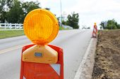 stock photo of flashers  - Construction cones on a road - JPG