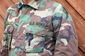 stock photo of army  - US Army soldier in camo uniform shirt - JPG