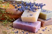 stock photo of bundle  - Natural handmade soaps with salt and lavender flowers - JPG