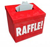 image of raffle prize  - Dropping tickets inside a raffle box for a 50 - JPG
