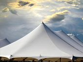 image of canopy roof  - tent tops against dramatic sky at twilight - JPG