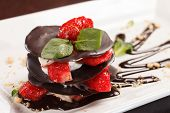 stock photo of dessert plate  - chocolate dessert with strawberry - JPG